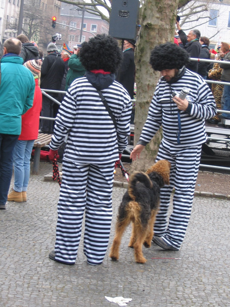 People wearing prisoner costumes at the Friedrich-Wilhelm-Platz square