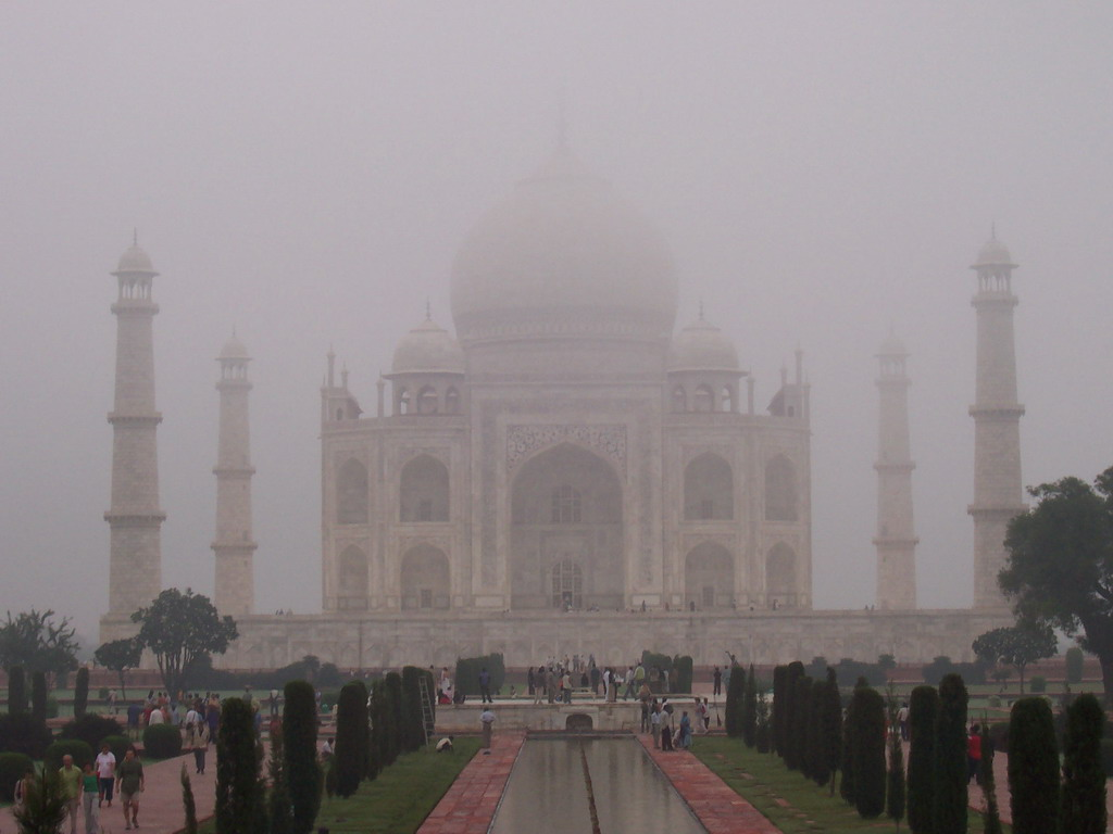 Charbagh Garden with the reflecting pool and the front of the Taj Mahal, in the mist