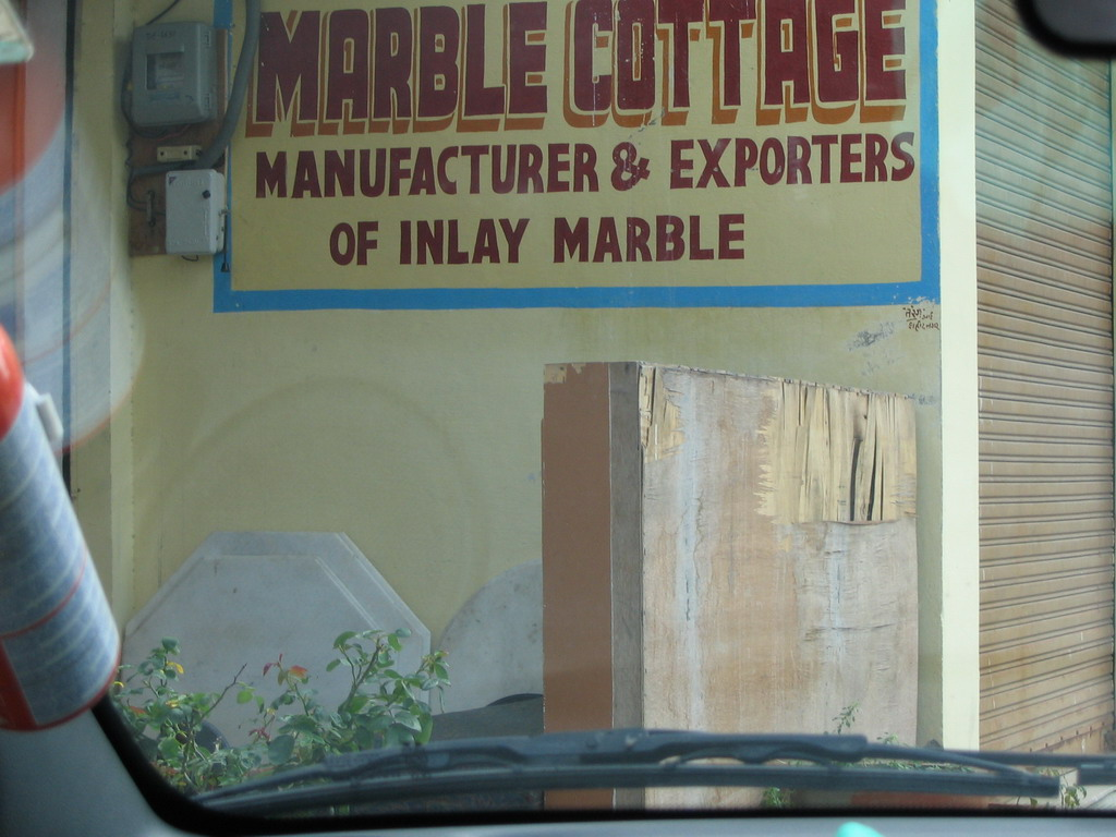 Sign in front of the Marble Cottage on the road to Sikandra