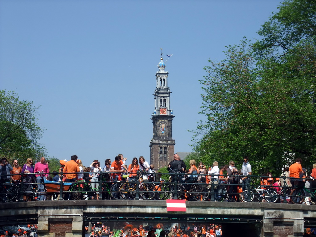 The bridge at the crossing of the Prinsengracht canal and the Reestraat street, and the tower of the Westerkerk church