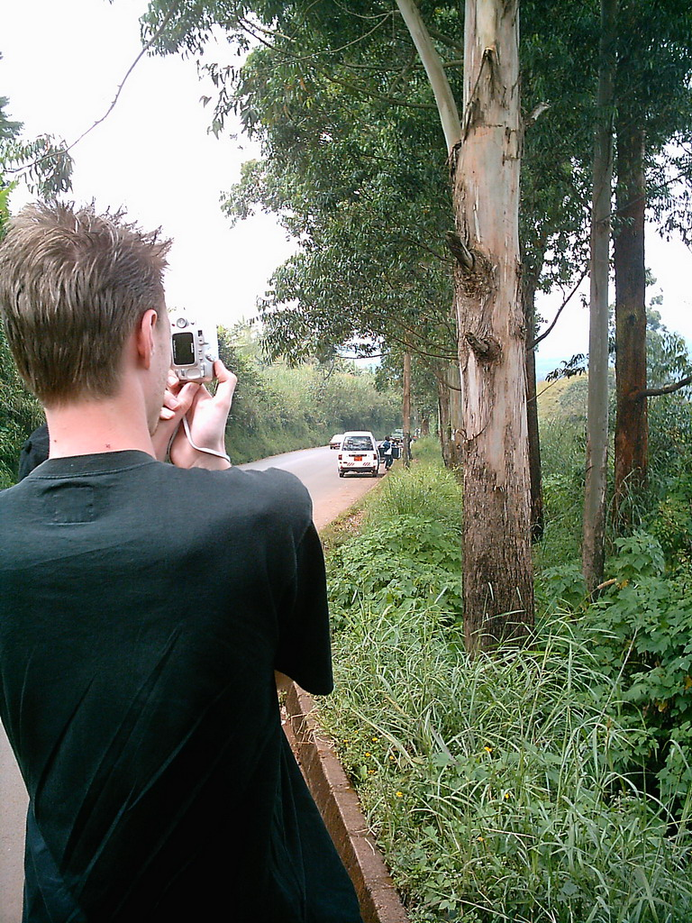 Tim`s friend making a photo at the road from Bafoussam