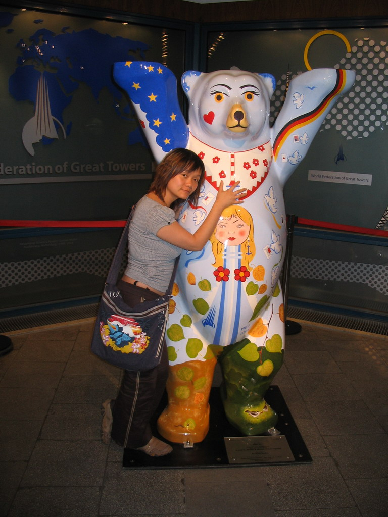 Miaomiao with a United Buddy Bear statue at the Fernsehturm tower