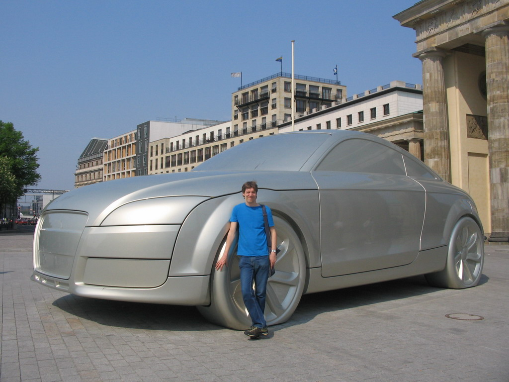 Tim with a giant Audi car at the back side of the Brandenburger Tor gate