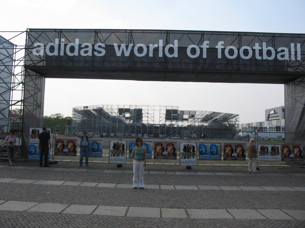 Miaomiao in front of the Adidas World of Football at the Platz der Republik square with a scale model of the Olympiastadion stadium