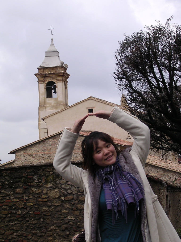 Miaomiao in front of a church in the town center