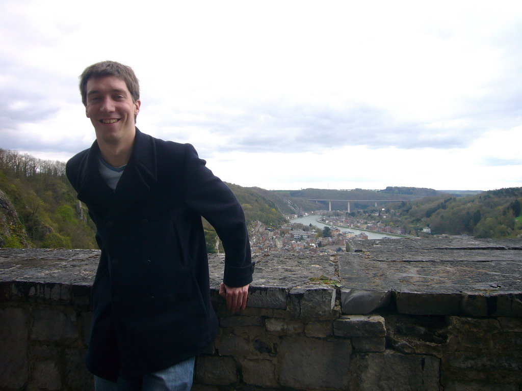 Tim at the Citadel of Dinant, with a view on the city center with the Route Charlemagne road and the Meuse river