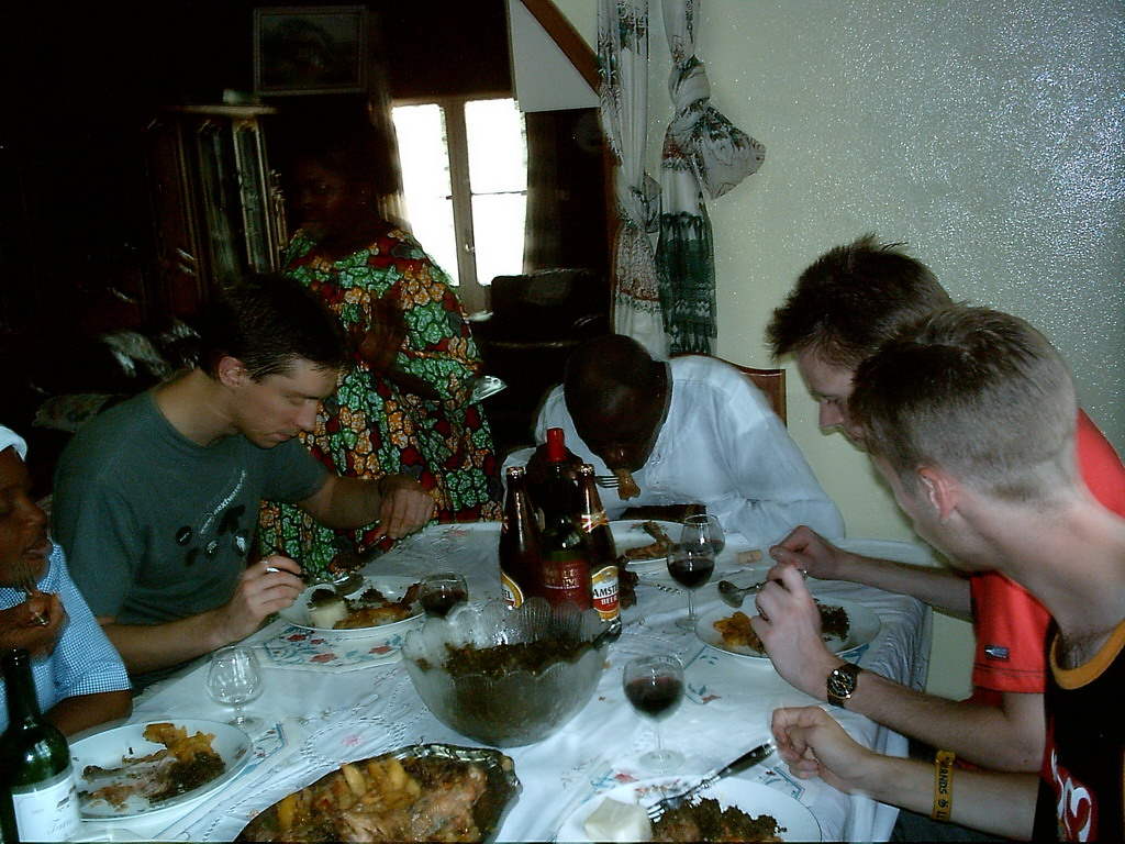 Tim and his friends eating at the chicken farmer`s house