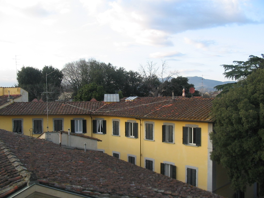 Houses and hills at the southwest side of the city, viewed from Miaomiao`s room at the La Chicca di Boboli hotel