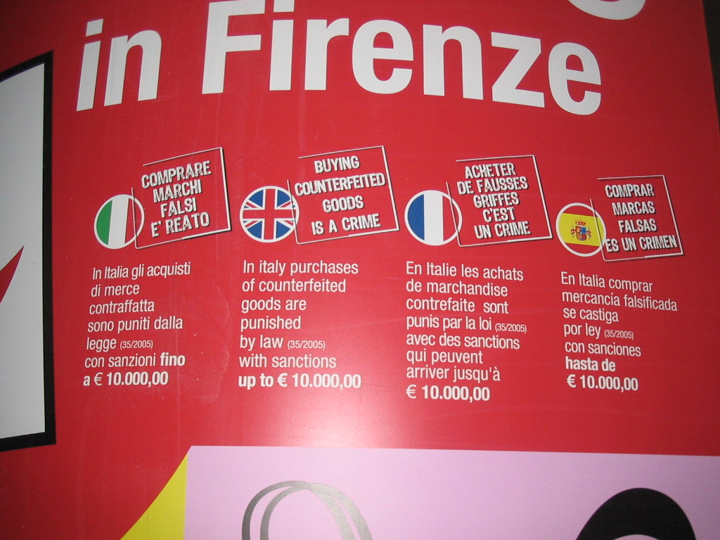 Information on buying counterfeited goods on a sign about shopping in Florence, in the city center