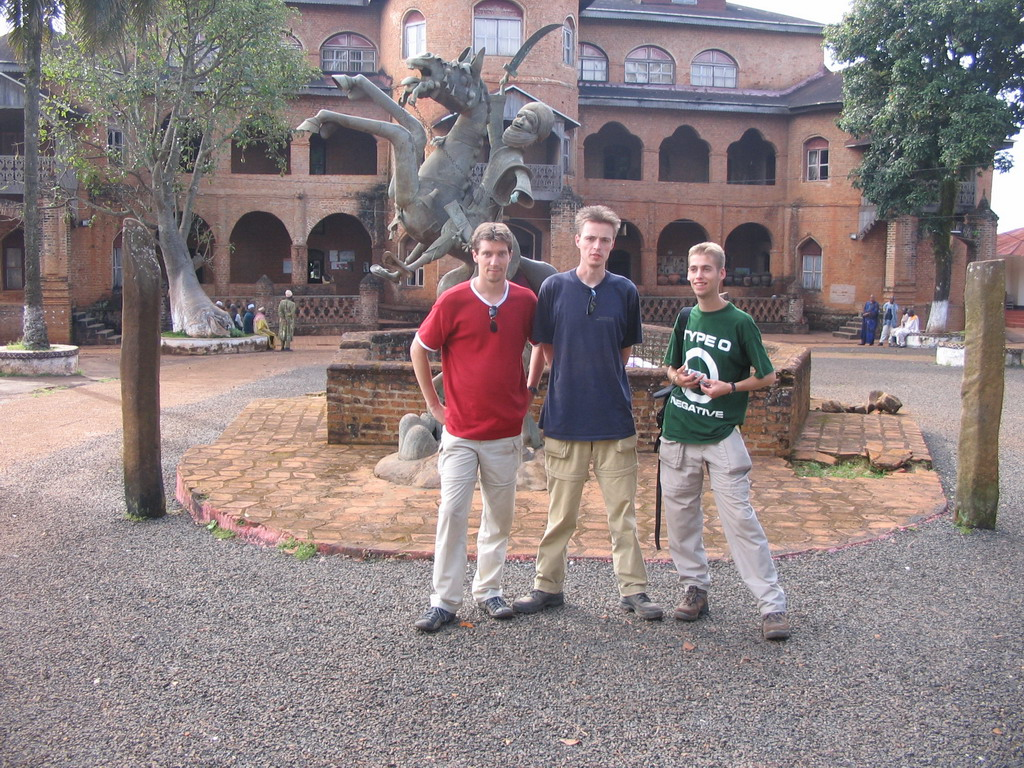 Tim, his friends and a statue in front of the Foumban Royal Palace