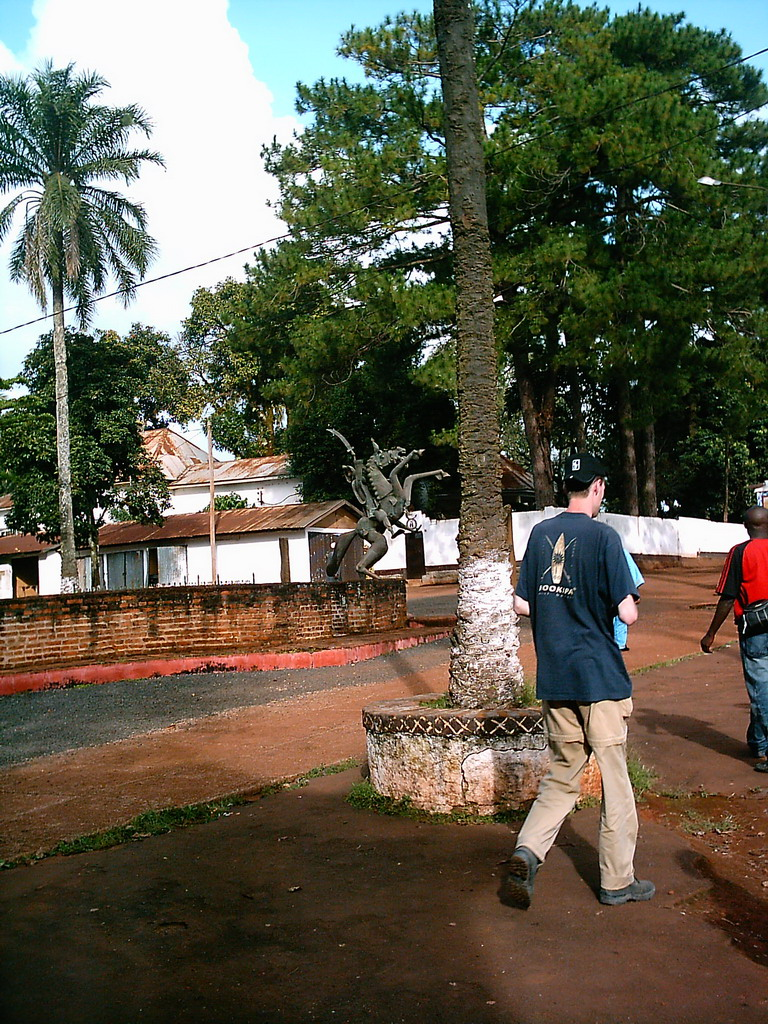 Tim`s and a statue in front of the Foumban Royal Palace