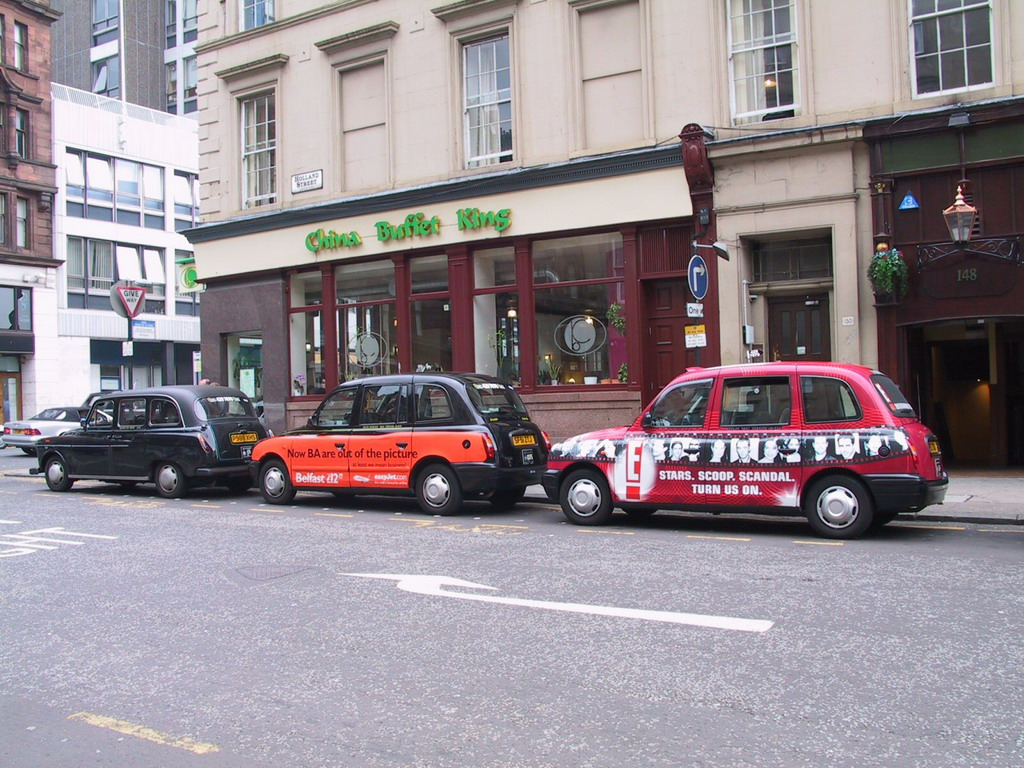 Taxis in front of the China Buffet King restaurant at Holland Street