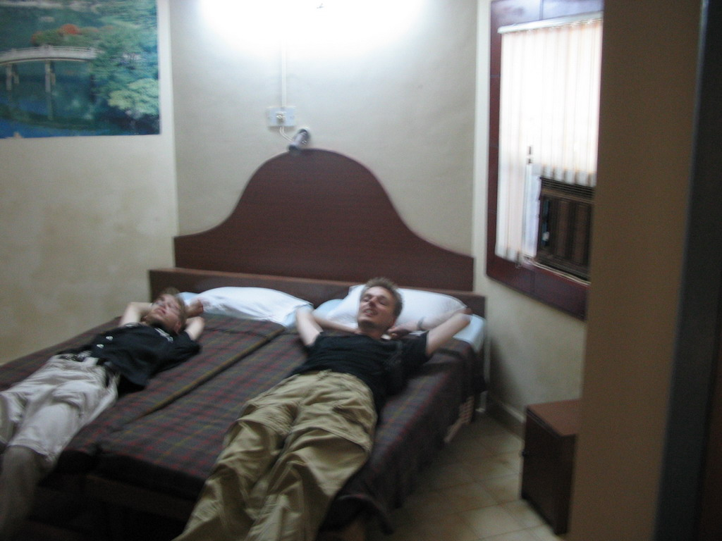 Rick and David on the bed in our room in the Colva Beach Resort