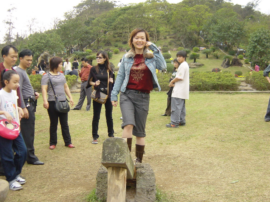 Miaomiao at the old village at the Hainan Volcano Park, with a view on the front of Mt. Fengluling volcano crater