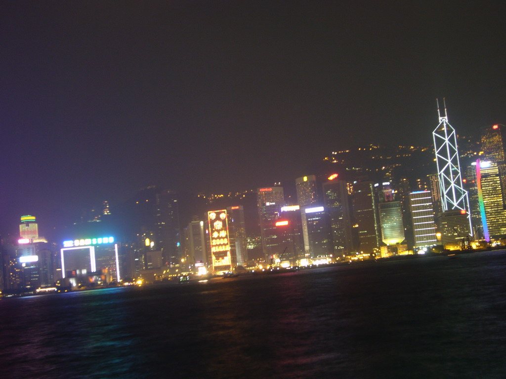 Victoria Harbour and the skyline of Hong Kong with the Bank of China Tower, viewed from the Avenue of Stars, during the `A Symphony of Lights` light and sound show, by night