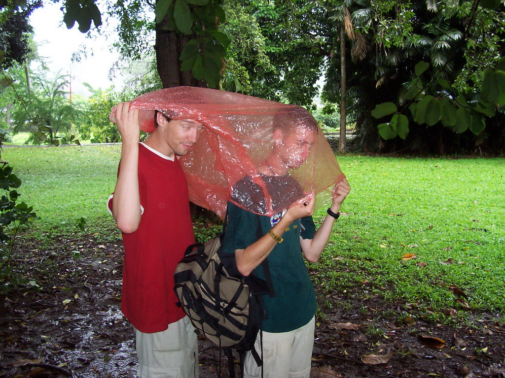 Tim and his friend under a rain coat at the Limbe Botanic Garden