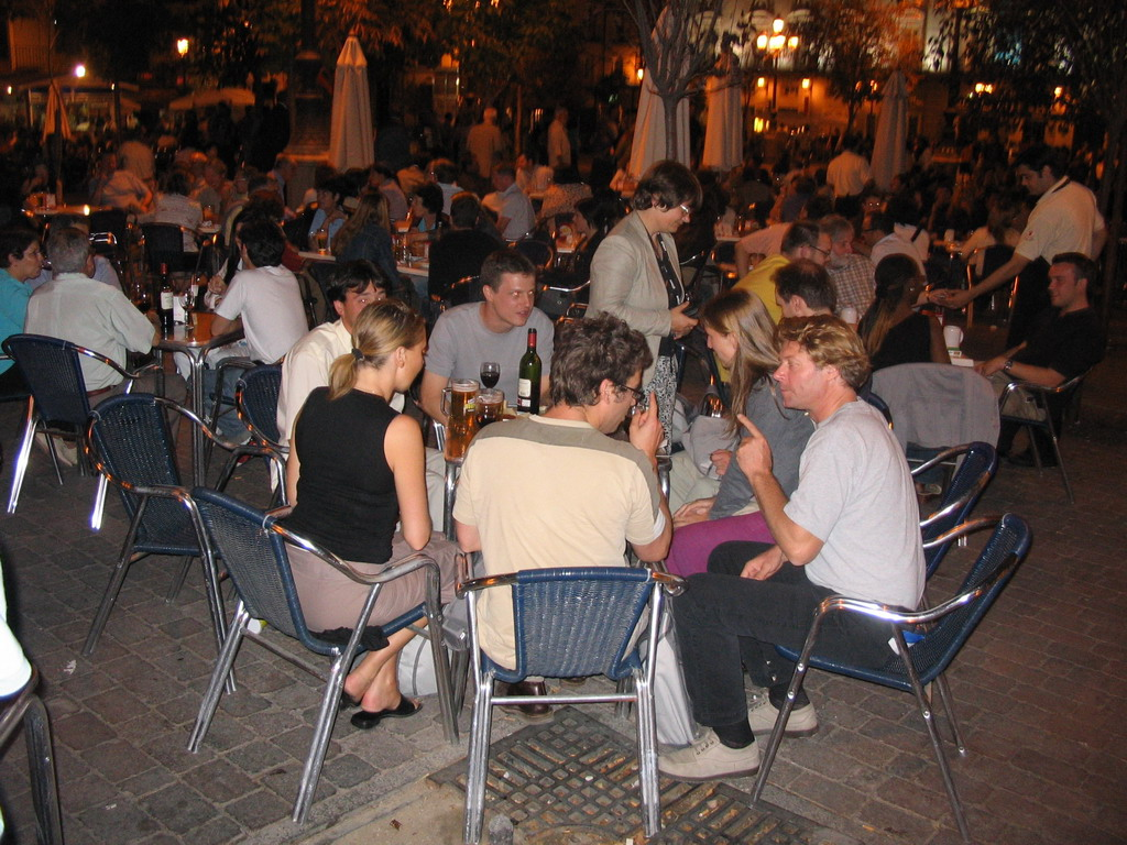 Terrace bar in the city center, by night