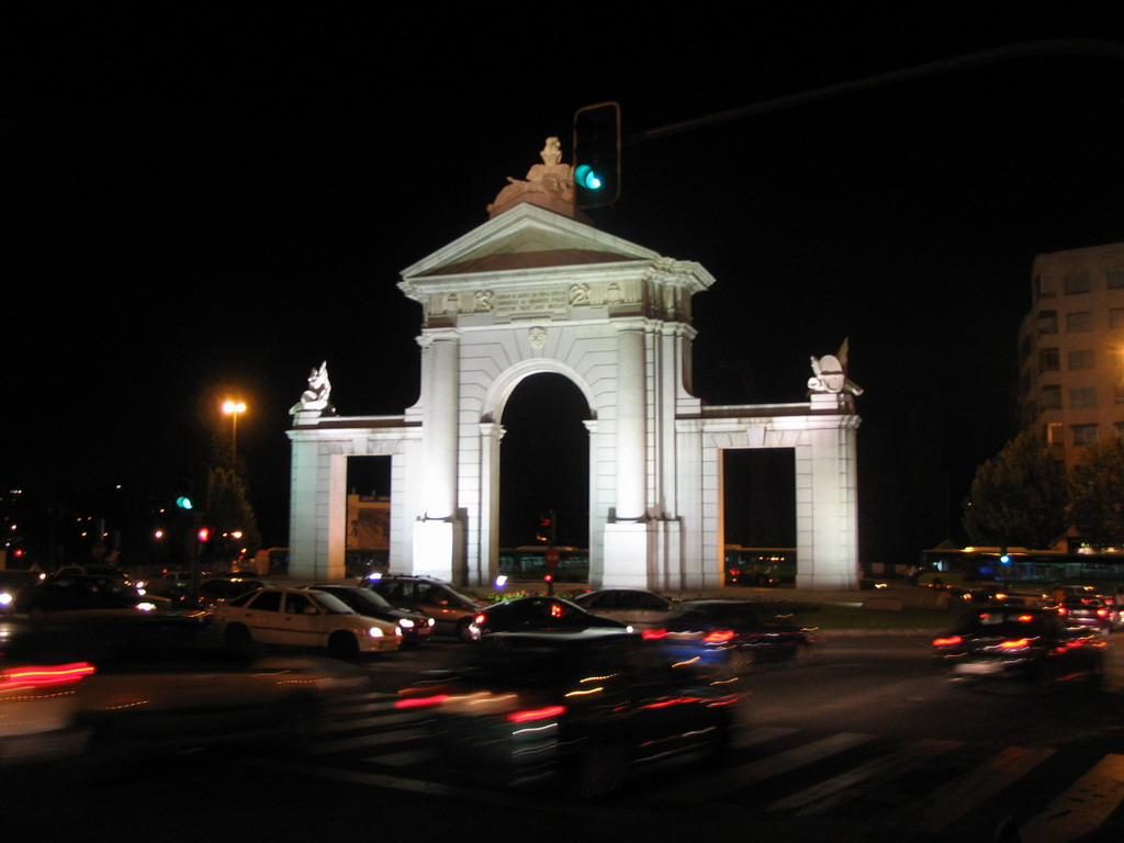 The Puerta de San Vicente gate at the Glorieta San Vicente square, by night