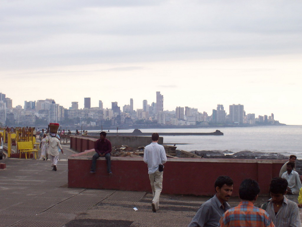 Tim and the skyline of Mumbai from a rock beach nearby
