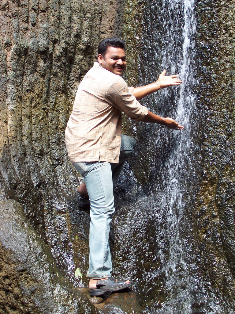 Our driver and a waterfall near the Kanheri Caves