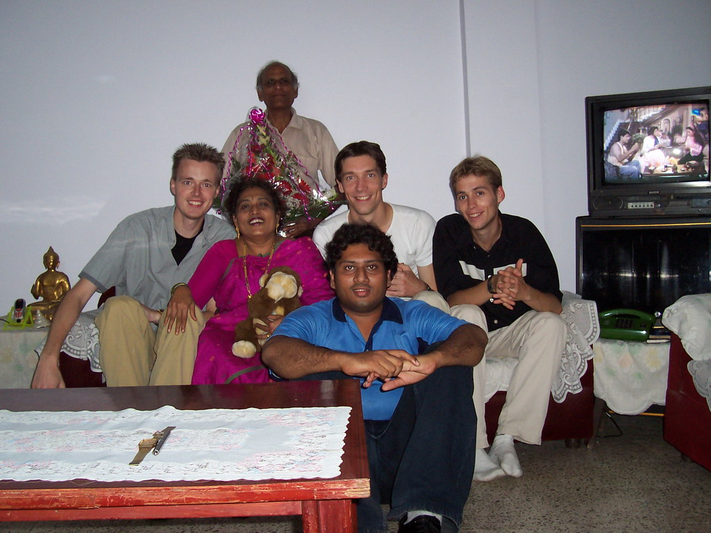 Tim, David, Rick, Swapnil and Anand`s parents with our flowers in the apartment of Anand`s family