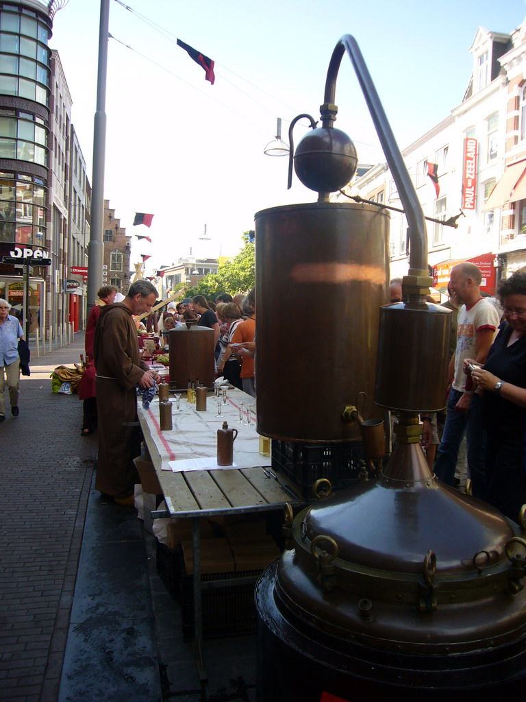 Person in medieval clothes selling wine at the Broerstraat street, during the Gebroeders van Limburg Festival