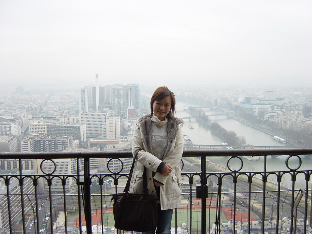 Miaomiao on the higher floor of the Eiffel Tower