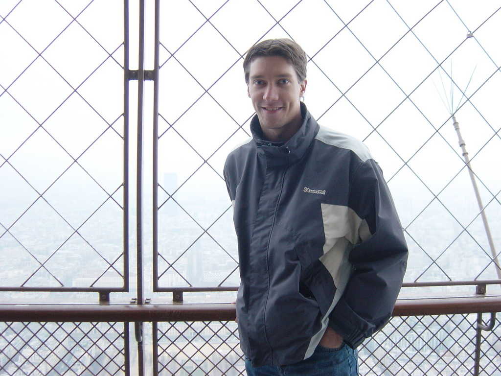 Tim on the higher floor of the Eiffel Tower