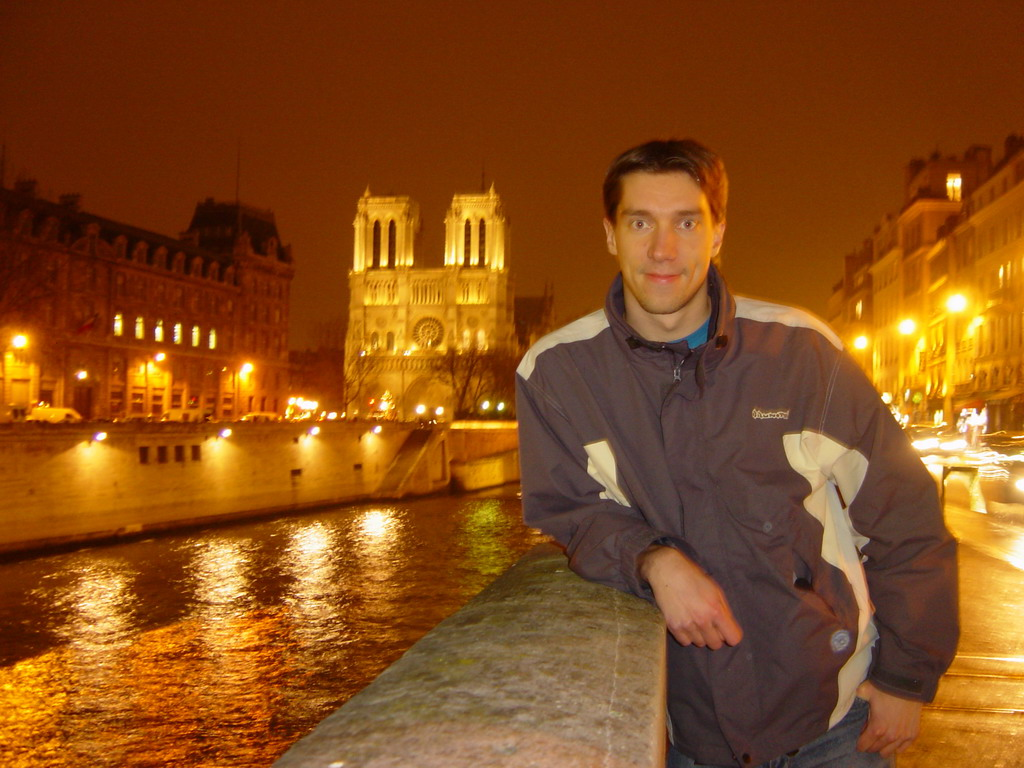 Tim with the Cathedral Notre Dame de Paris and the river Seine, by night