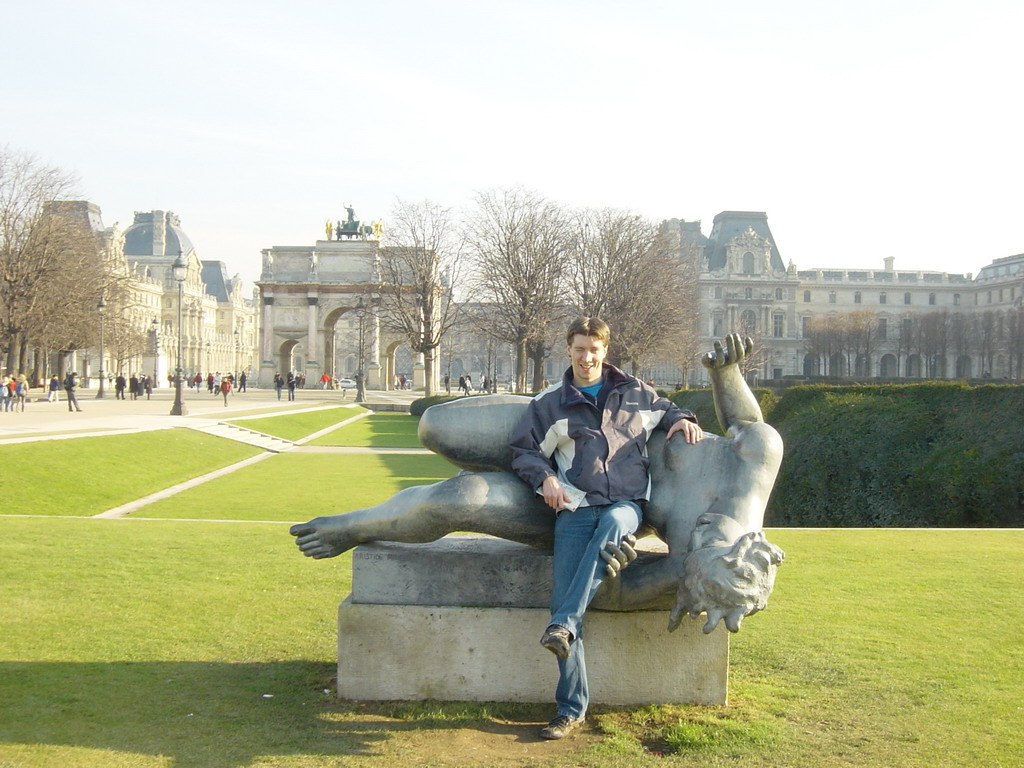 Tim with a statue in the Tuileries Garden, and the Arc de Triomphe du Carousel in front of the Louvre Museum