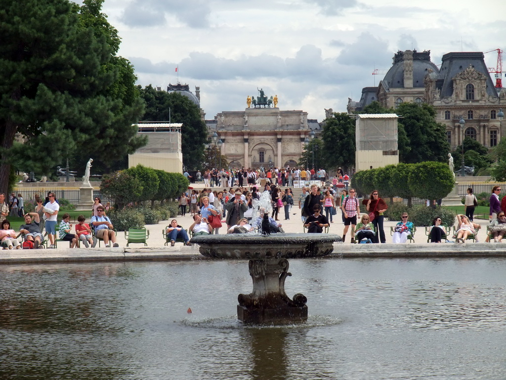 The Grand Bassin Rond in the Tuileries Garden, the Arc de Triomphe du Carousel and the Louvre Museum