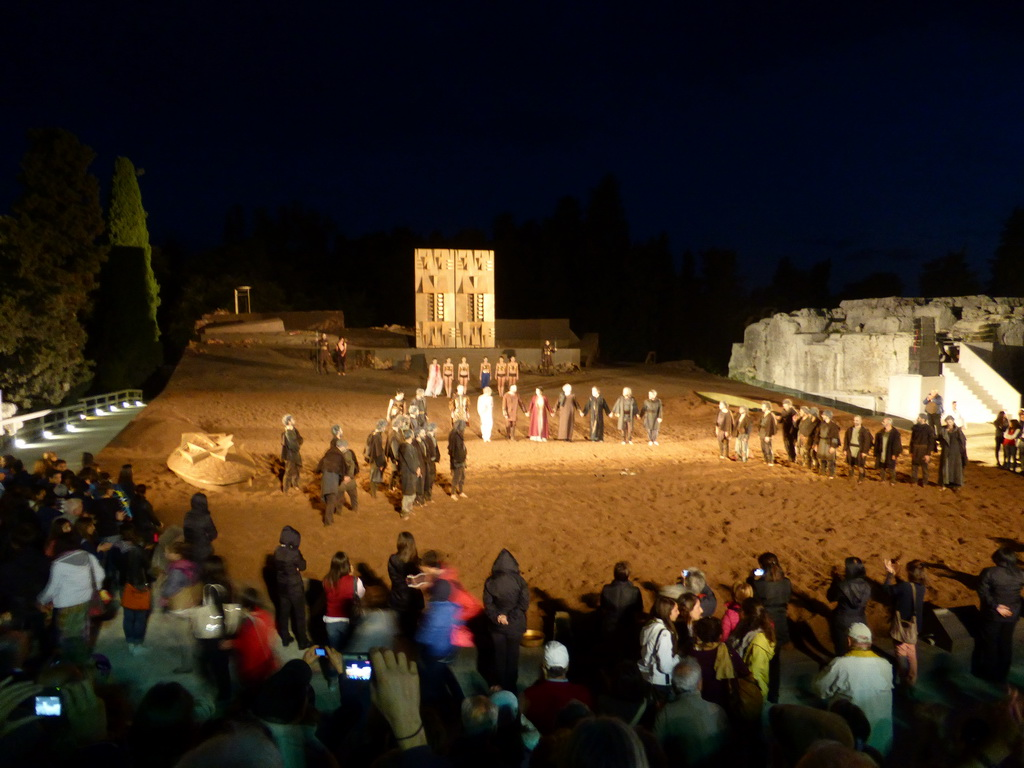 Actors receiving applause at the stage of the Greek Theatre at the Parco Archeologico della Neapolis park, at the end of the play `Agamemnon` by Aeschylus