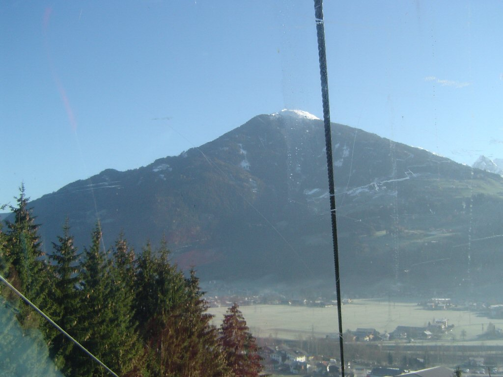 Mountain and trees, viewed from the ski lift to the Hochzillertal ski resort